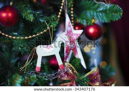 Shiny Christmas balls hanging on pine branches - stock photo