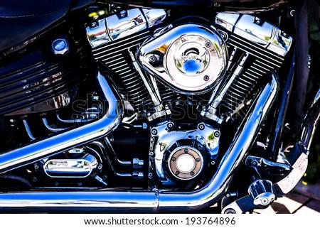 Shiny chrome motorcycle engine block - stock photo