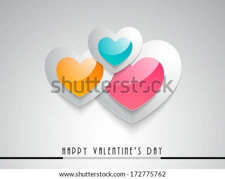 Shiny colorful glossy heart shapes on grey background for Happy Valentines Day concept.