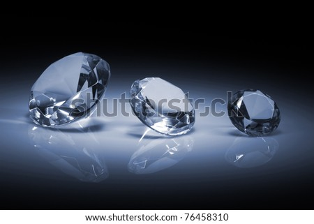 Shiny diamonds jewel on dark blue background - stock photo