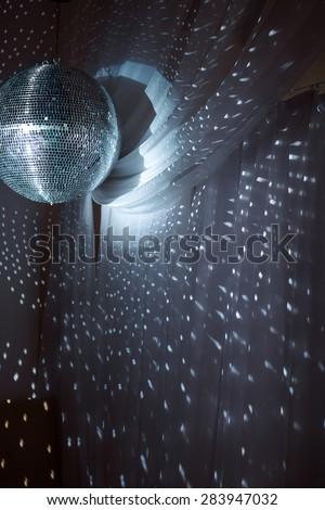 Shiny disco ball on nightclub good for background - stock photo