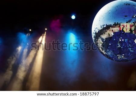 Shiny disco ball with smoke - stock photo
