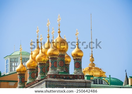 Shiny golden domes of the Upper savior Cathedral in Cathedral Square in Moscow Kremlin - stock photo