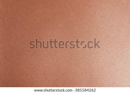 Shiny hot copper red bronze color decorative texture paper: Bright brilliant festive glossy metallic look textured empty wallpaper backdrop: Aluminium tin metal material for craft design decoration - stock photo