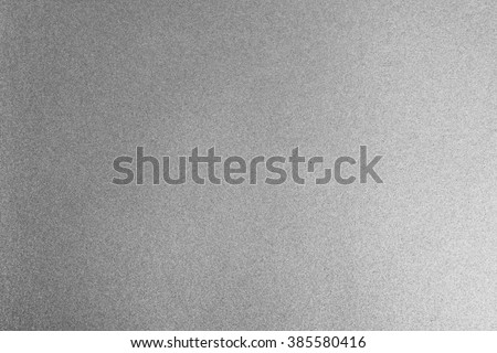 Shiny hot silver grey gray decorative texture paper: Bright brilliant festive glossy metallic look textured empty wallpaper backdrop: Aluminium tin metal like material for craft design decoration - stock photo