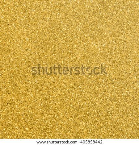 Shiny hot yellow gold golden color decorative texture paper: Bright brilliant festive glossy metallic look textured empty wallpaper backdrop: Aluminium tin metal material for craft design decoration - stock photo