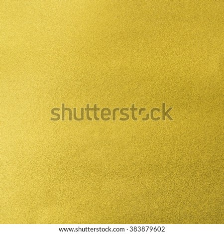 Shiny hot yellow gold paper foil leaf decorative texture background: Bright brilliant festive glossy metallic look textured backdrop: Metal steel like material pattern surface for design decoration - stock photo