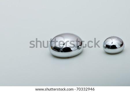 Shiny Mercury drops on a white background - stock photo
