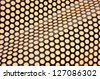 Shiny metal surface background with holes - stock photo