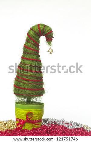 Shiny miniature Christmas tree made of sisal with beads - stock photo