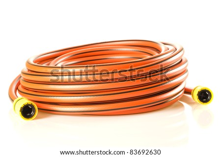 Shiny new gardening hose. 20 meters long, 12.5 mm diameter.. - stock photo
