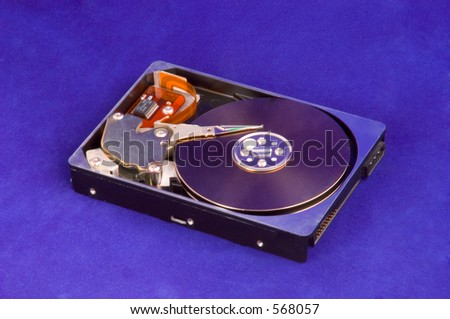 Shiny Opened Hard Drive (HDD) on the blue background. - stock photo