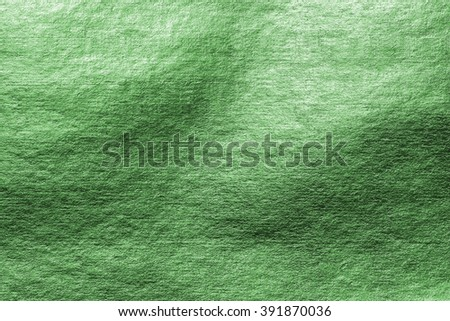 Shiny parrot green color foil leaf paper decorative texture background: Crumpled bright brilliant festive glossy metallic backdrop: Aluminium tin metal steel material for design decoration:  - stock photo