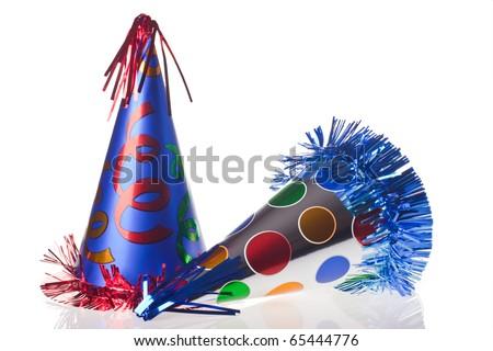 Shiny party hats on white background - stock photo