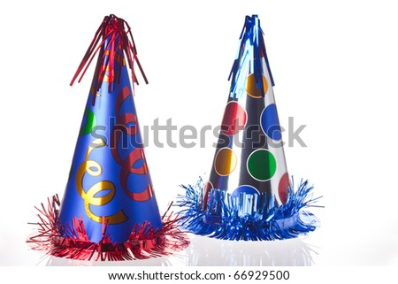 Shiny party hats on white background - stock photo