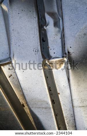 Shiny Piece of Sheet Metal with Bent Texture - stock photo