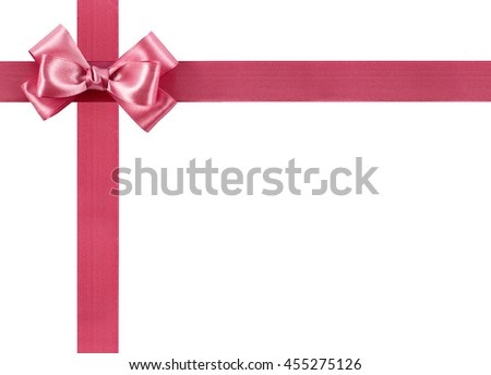 Shiny pink ribbon bow isolated on white background