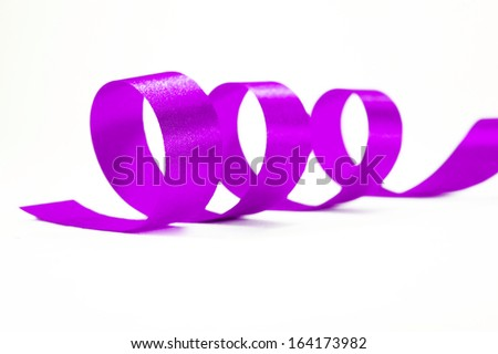 Shiny purple satin ribbon on white background with copy space. Macro with extremely shallow DOF. - stock photo