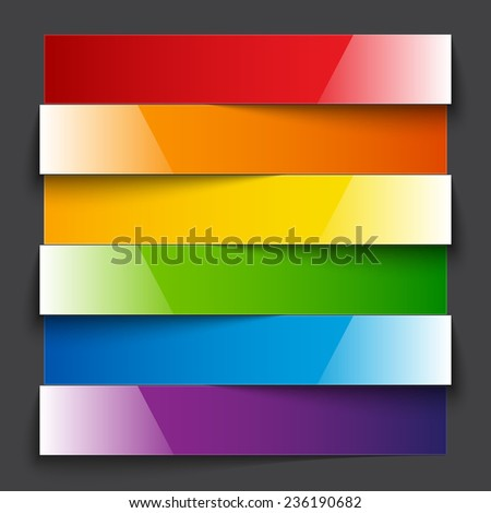 Shiny rainbow paper stripe banners with shadows on dark grey background - stock photo