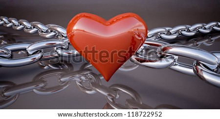 Shiny red heart and a chain on a dark gray background - stock photo