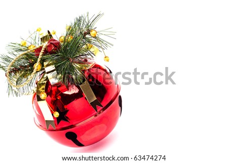 Shiny red jingle bell with a holly spring, ribbon on an isolated on white with copy space - stock photo
