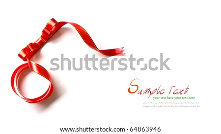 Shiny red ribbon on white background with copy space. - stock photo
