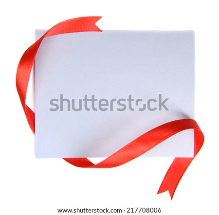 Shiny red ribbon with card isolated on white - stock photo