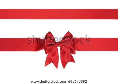 Shiny red satin gift bow and ribbon isolated on white