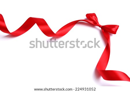 Shiny red satin ribbon and bow isolated on white - stock photo