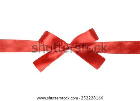 Shiny red satin ribbon on white background - stock photo