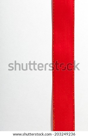Shiny red satin ribbon on white background with copy space. Greeting card note or blank sale tag - stock photo