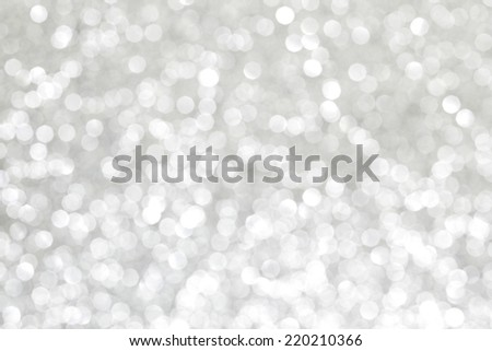 Shiny silver defocused glitter holiday background - stock photo