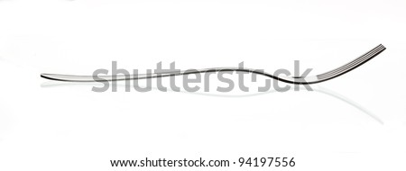 shiny silver fork over white background with reflection - stock photo