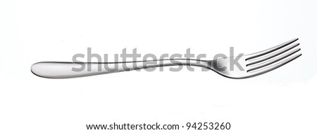 shiny silver fork over white background with reflection