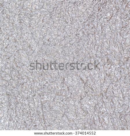 Shiny silver grey aluminum foil decorative texture background: Crumpled bright brilliant festive glossy metallic look textured backdrop: Aluminium tin metal like material surface for design decoration - stock photo