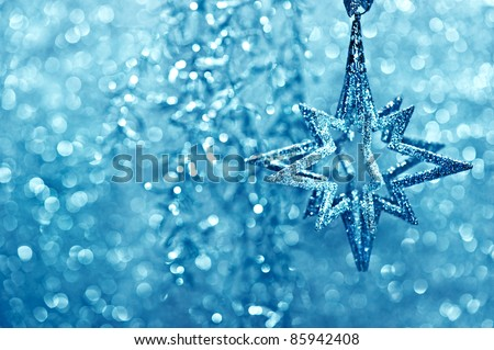 shiny silver star. festive glittering decoration. christmas or new year card concept - stock photo