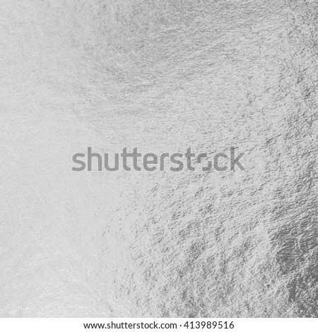 Shiny silver white grey gray paper foil decorative texture background: Bright brilliant festive glossy metallic look textured backdrop:  Metal steel zinc material pattern surface for design decoration - stock photo