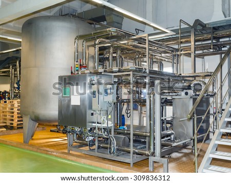 shiny stainless steel pipes, tanks for the food industry - stock photo