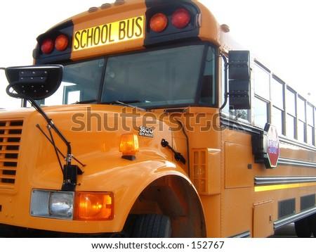 Shiny Yellow School Bus - stock photo