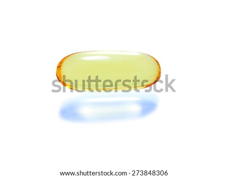 shiny yellow vitamin omega3 fish oil capsule on white background. - stock photo