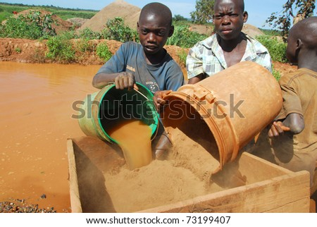 SHINYANGA,TANZANIA - CIRCA MARCH 2010: Child gold miners, Aziz and Abdulay, age 15 circa March 2010 in Shinyanga, Tanzania. Tanzania is the third largest gold producer in Africa - stock photo