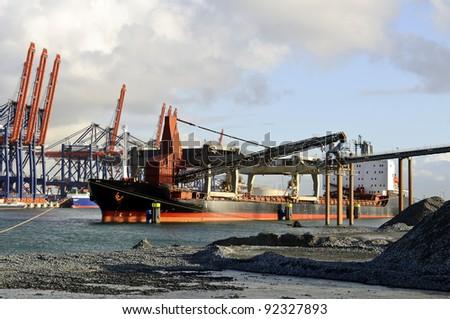 ship activity in de harbor of rotterdam netherlands - stock photo