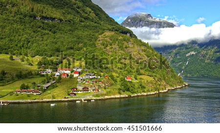 Ship approach to the village of Geiranger at the end of the beautiful Geiranger Fiord in Norway