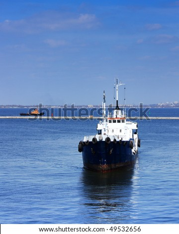 ship arriving to port - stock photo