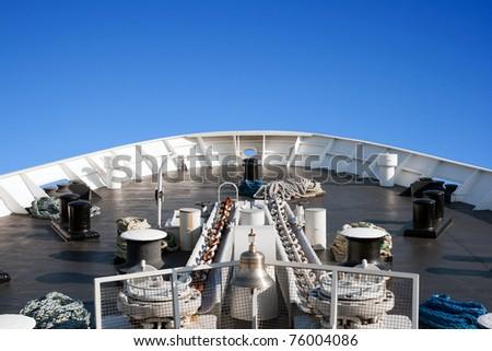 Ship bow on a blue sky - stock photo