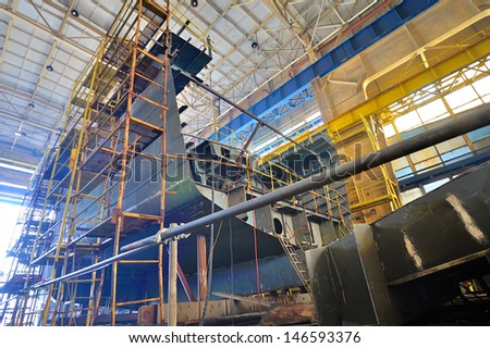Ship building shoot inside of shipyard - stock photo