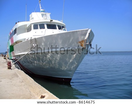 ship docked at pier - stock photo