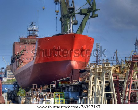 Ship during construction works in a shipyard on a shipway - stock photo