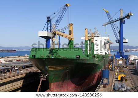 Ship in dry dock for repairs - stock photo