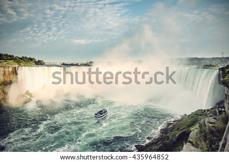 Ship in front of Horseshoe Fall, Niagara Falls, Ontario, Canada, Vintage filtered style - stock photo